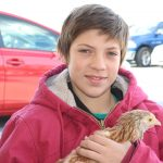 Ryan Thomas having some bonding time with a chicken in the petting zoo.