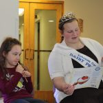 Lebanon County Dairy Princess Millena Bashore reads a book to a young COGS member.
